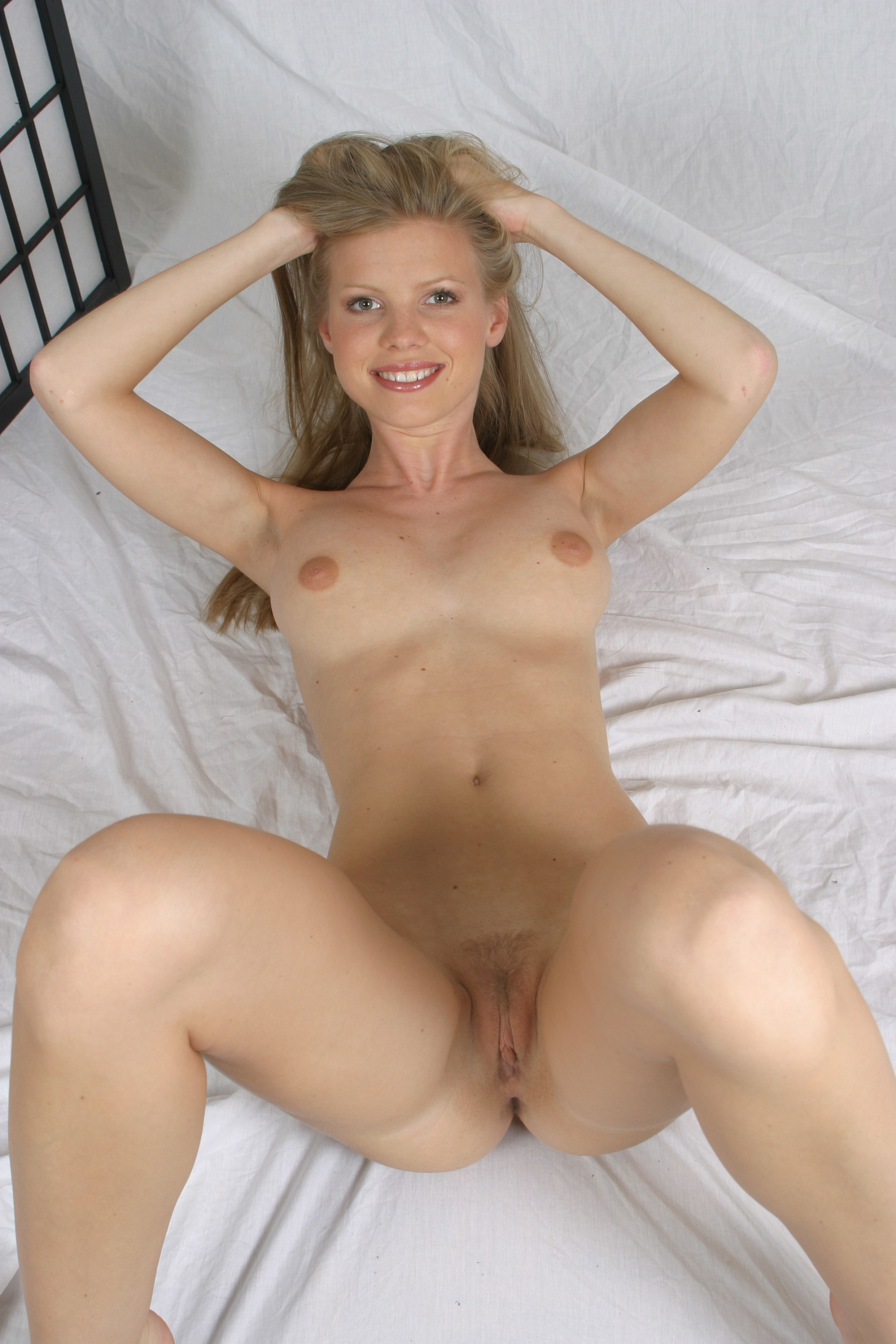 Beautiful blonde with nice rack uses dildo in bedroom 6