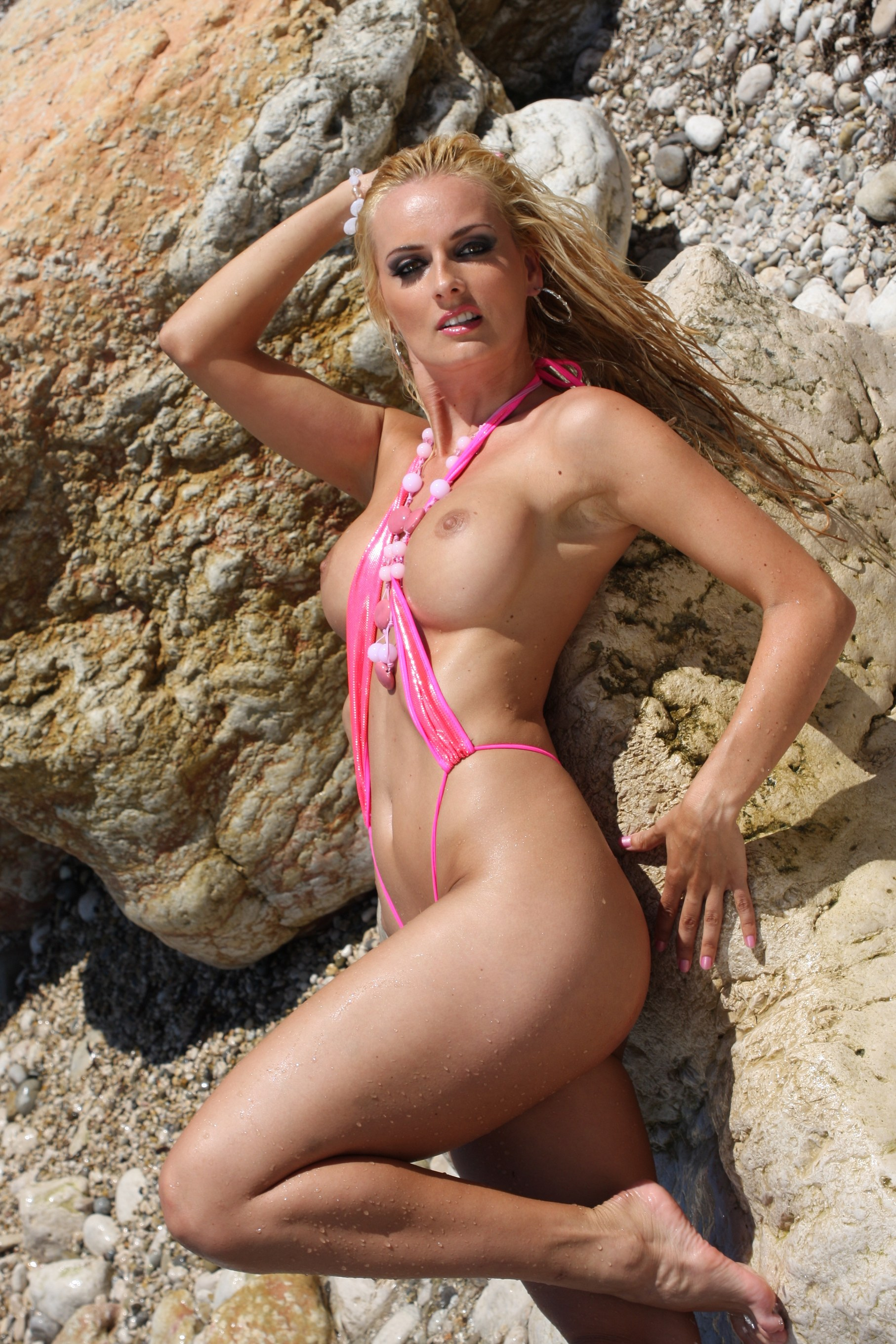 Blonde strips at beach