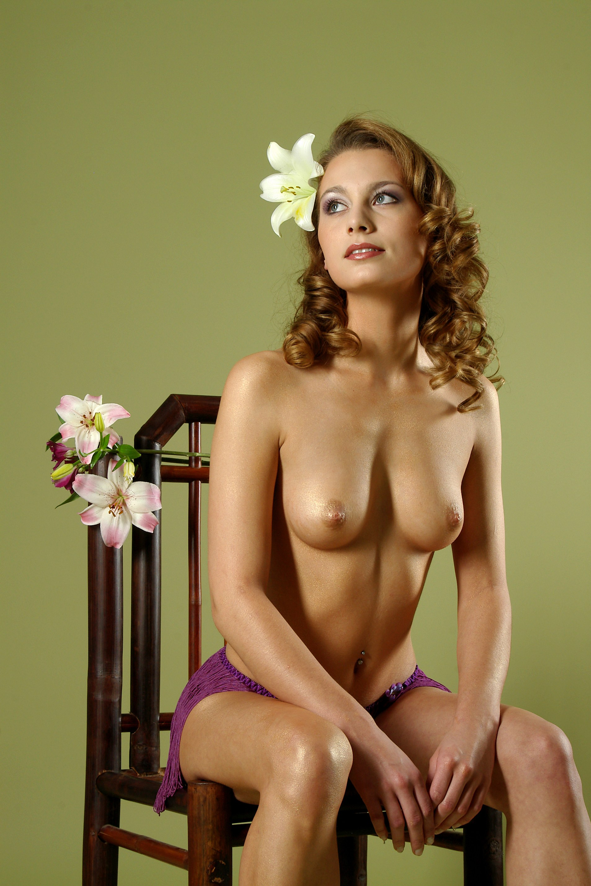 cute coed christin posing topless in a chair sweet t and a