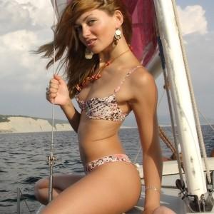 Lilya Stripping on a Sail Boat